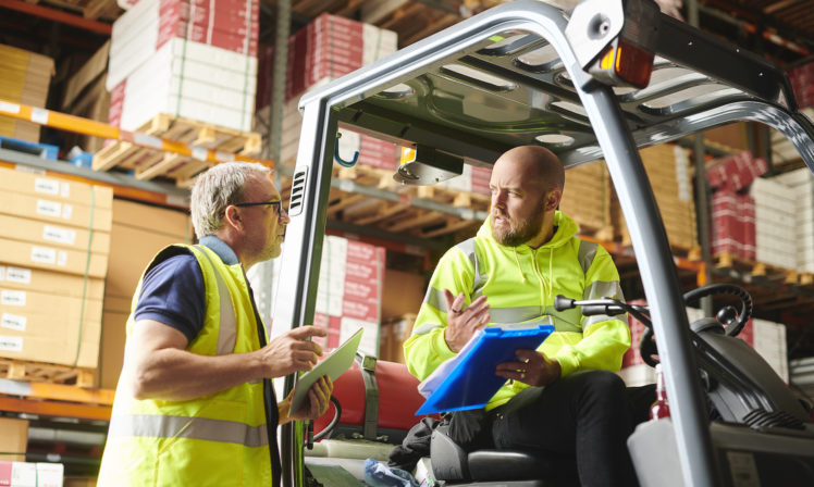 A busy retail warehouse gets delivery from same day courier Speedy Freight