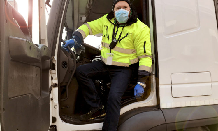 Lorry drive wearing a face mask for safety